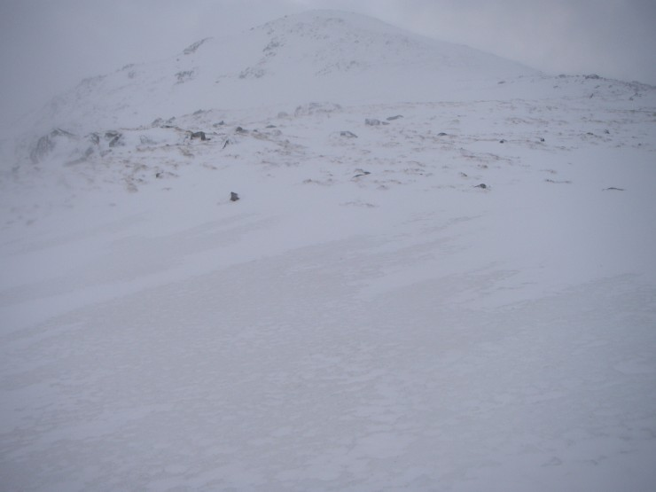 The old hard and greyer snowpack with fresh whiter  windslab being deposited on top.