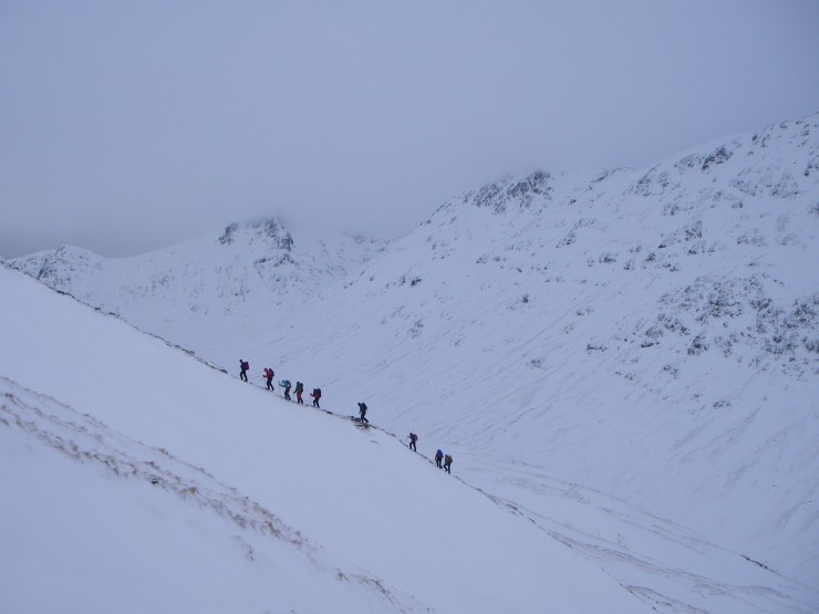 A mountaineering group heads up Buachaille Etive Beag