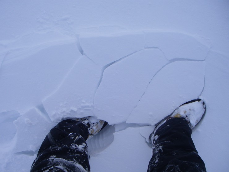 Cracking underfoot at the edge of a drift. The fresh windslab is not very stable.