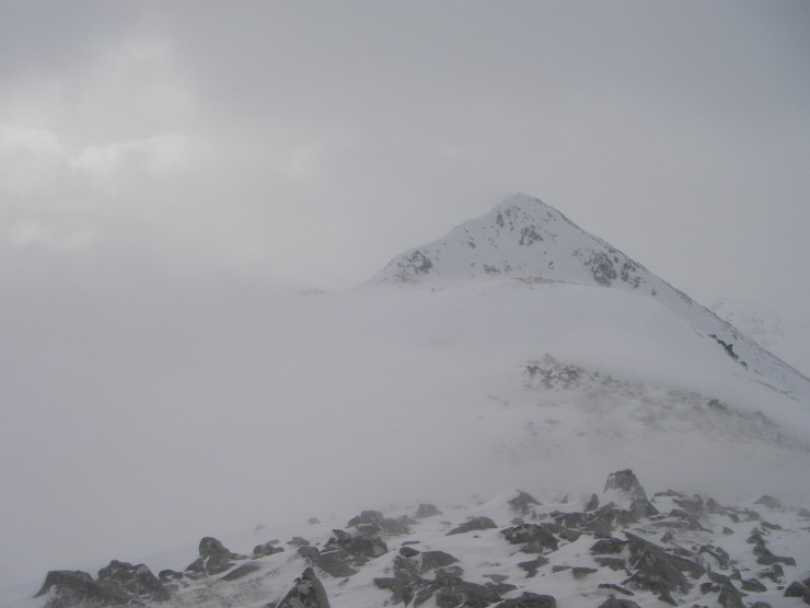 Spindrift blowing on Buachaille Etive Beag. Spot the group of walkers.