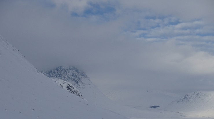 Buachaille Etive Mor looming out of the mist and snow covered glen.