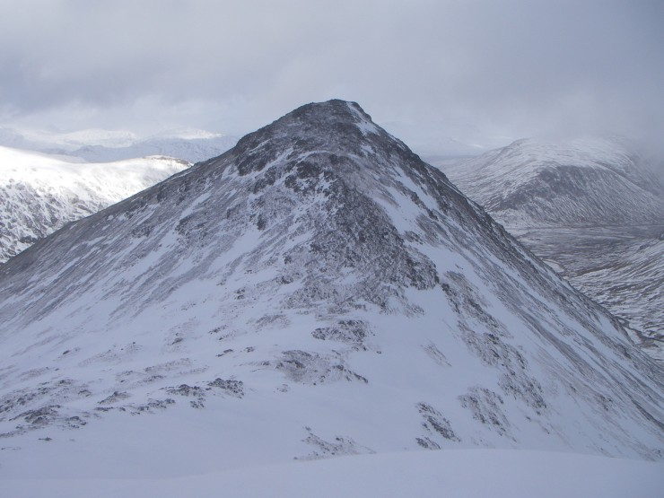 The S.W. flank of Stob Coire Raineach (925m.) is scoured to its summit.
