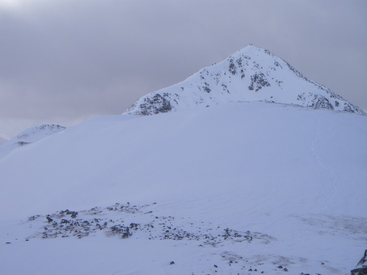 Walker approaching and on the summit of Stob Dubh.