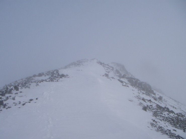 The summit of Meall a Bhuiridh shrouded in mist.