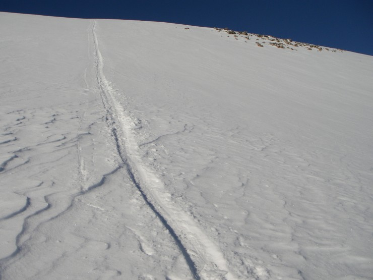 The snow was quite variable. Softening in the heat of the sun, as shown by my bum slide track.