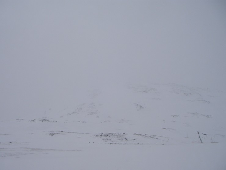 The NE flank of Meall a Bhuiridh glimpsed during a clearance in the visibility