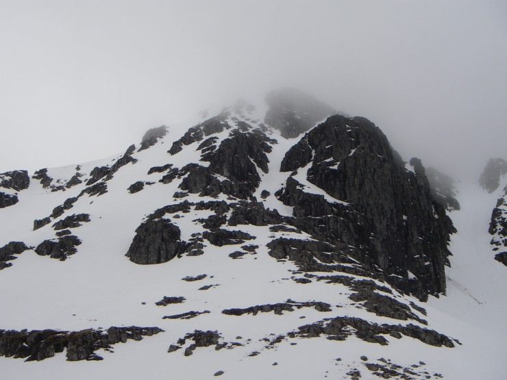 Stob Coire nan Lochan's summit obscured by mist, the upper couloir of Boomerang Gully visible in centre of picture.