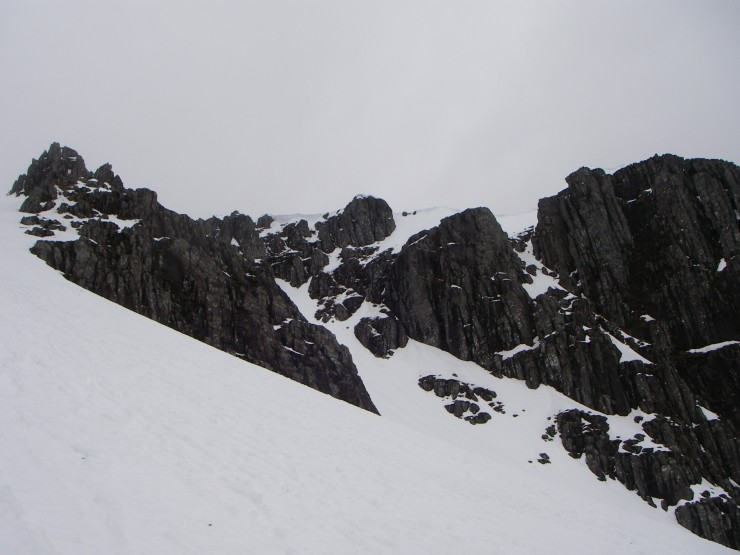 Still some sizeable cornices left, these above Twisting Gully.