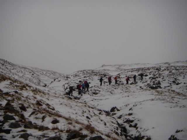 Plenty of people on the hill despite the conditions, approaching the bealach on Buachaille Etive Beag.
