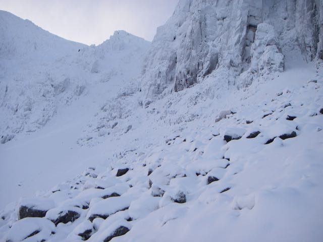 Below the crags in Coire nan Lochan light snow on the boulders