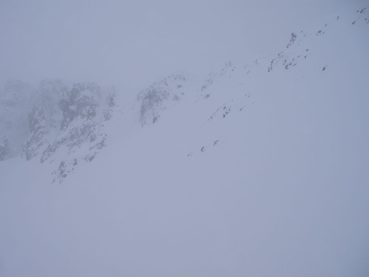 The lower part of the rim of the corrie - hard to see how much of a cornice has developed through the mirk