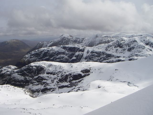The 'stacked' ridges of the Glencoe hills-Gearr Aonach to Stob Dearg, in the distance.